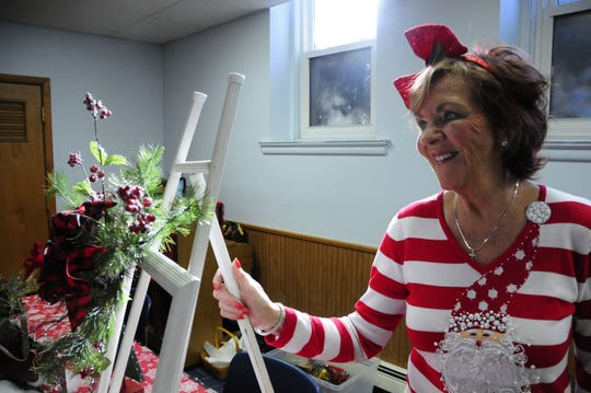 Judy Hall shows off some of the craft items she made for the Miracle Marketplace, Saturday, Nov. 3, 2018 at First Presbyterian Church.