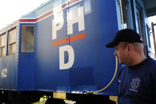 Dan Meinhard looks at a restored caboose at the Port Huron & Detroit Railroad Historical Society building in Port Huron Township.