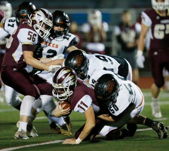 Marlboro's, from left, Dylan Ten Eyck and Matthew Jennison tackle O'Neill's quarterback, Josh Borowicz during Friday's Section 9 class B football final in Kingston on November 2, 2018.