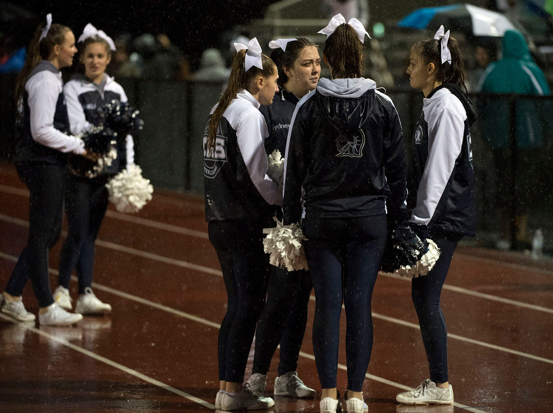 Trojan cheerleaders work in the rain. Chambersburg Trojans dropped a close game 20-17 to Manheim Township Blue Streaks in the rain during PIAA District 3 playoff football on Friday, Nov. 2, 2018.
