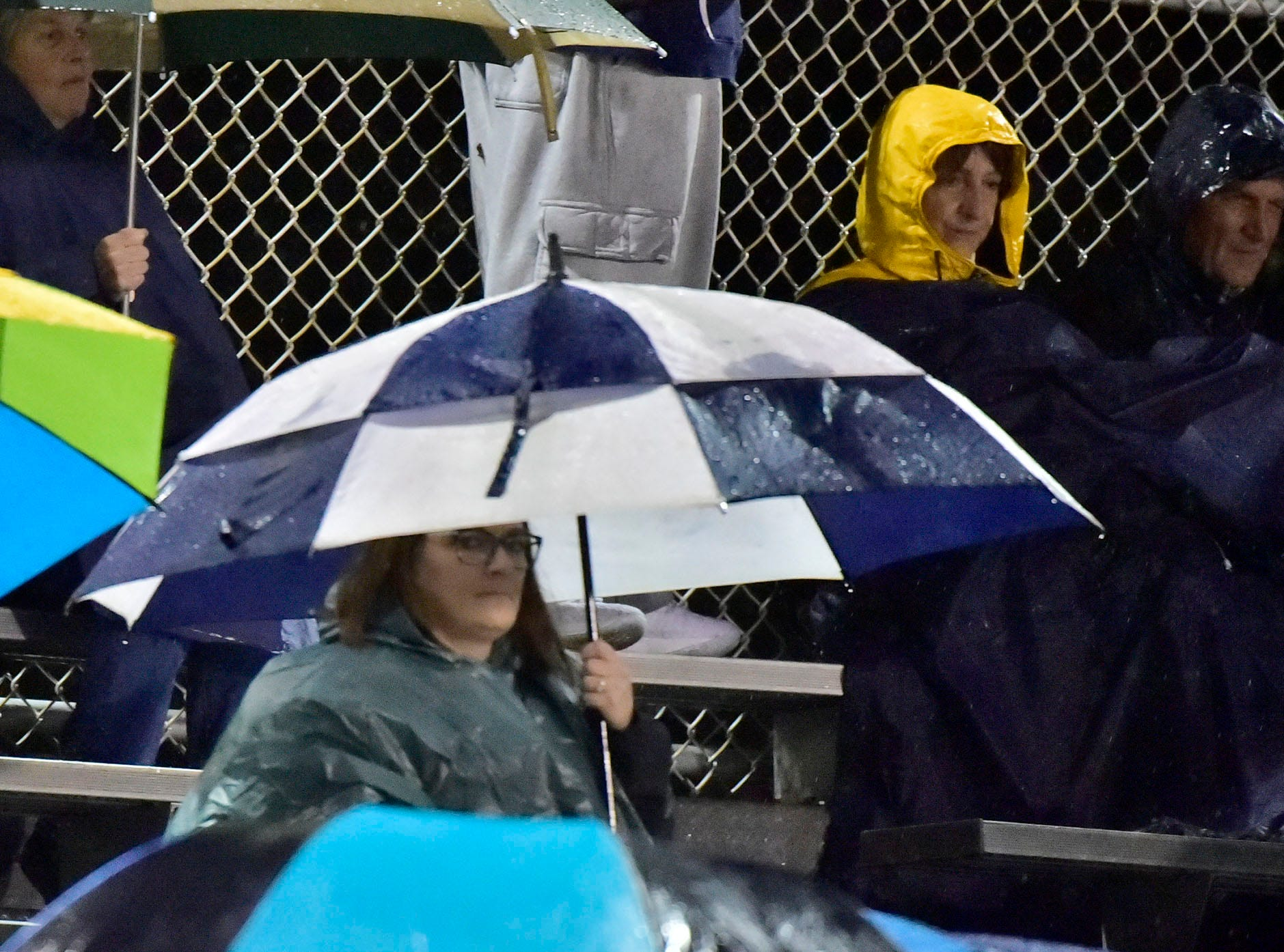 Fans sit through a rainy ball game. Chambersburg Trojans dropped a close game 20-17 to Manheim Township Blue Streaks in the rain during PIAA District 3 playoff football on Friday, Nov. 2, 2018.