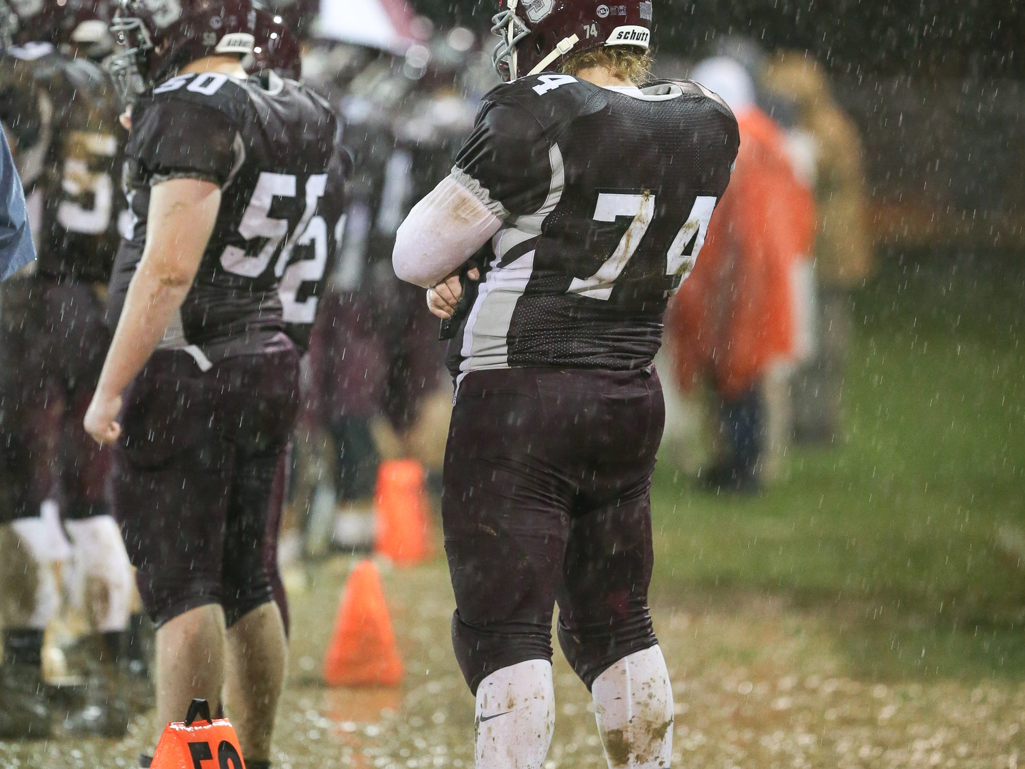 Sophomore Daulton Foore stands on the muddy sideline. The Shippensburg Greyhounds defeated Northeastern 6-0 in a playoff game in Shippensburg on Friday, Nov. 2, 2018.