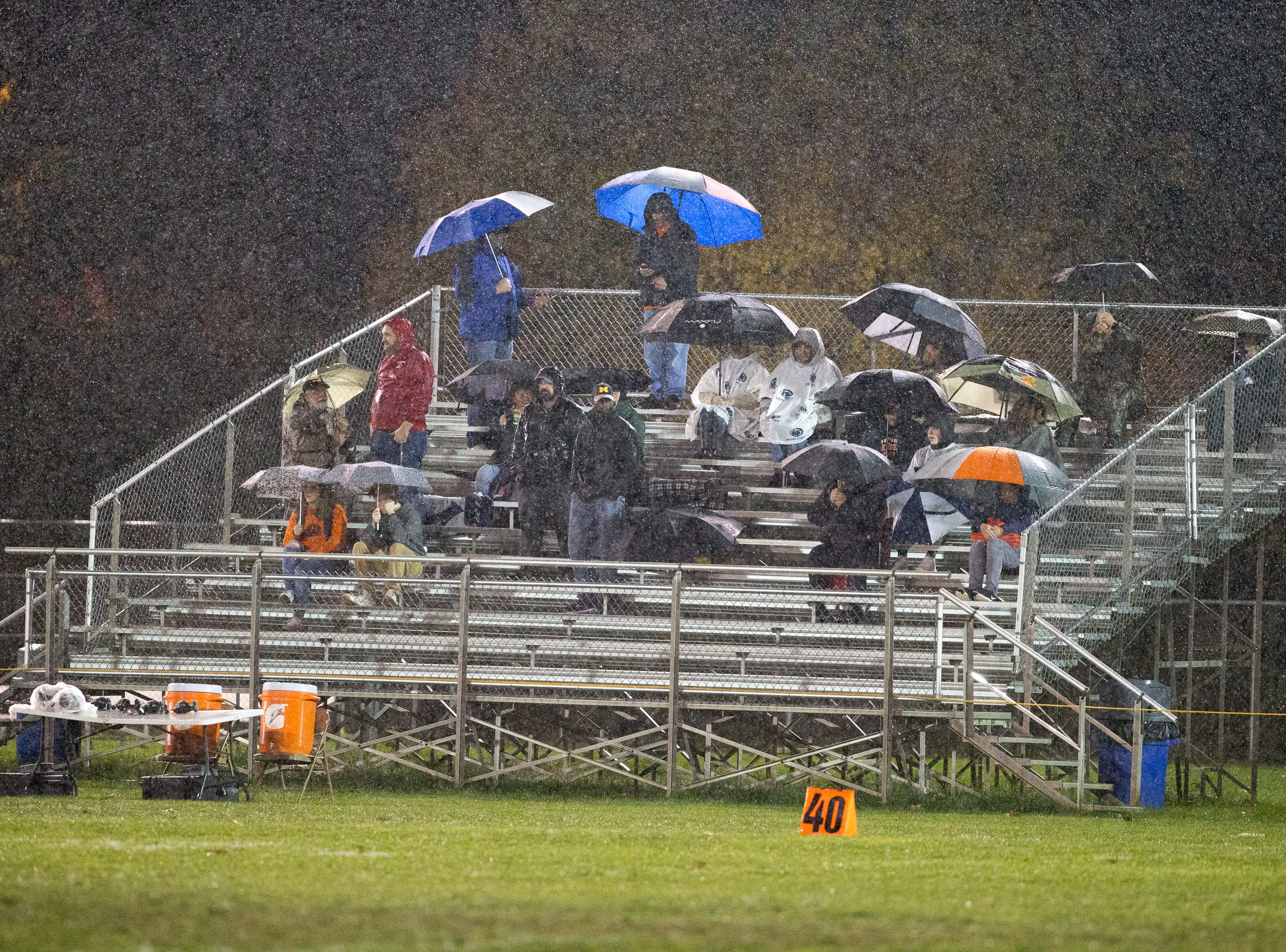 Dedicated fans battle the rain. The Shippensburg Greyhounds beat Northeastern 6-0 in a playoff game on Friday, Nov. 2, 2018.