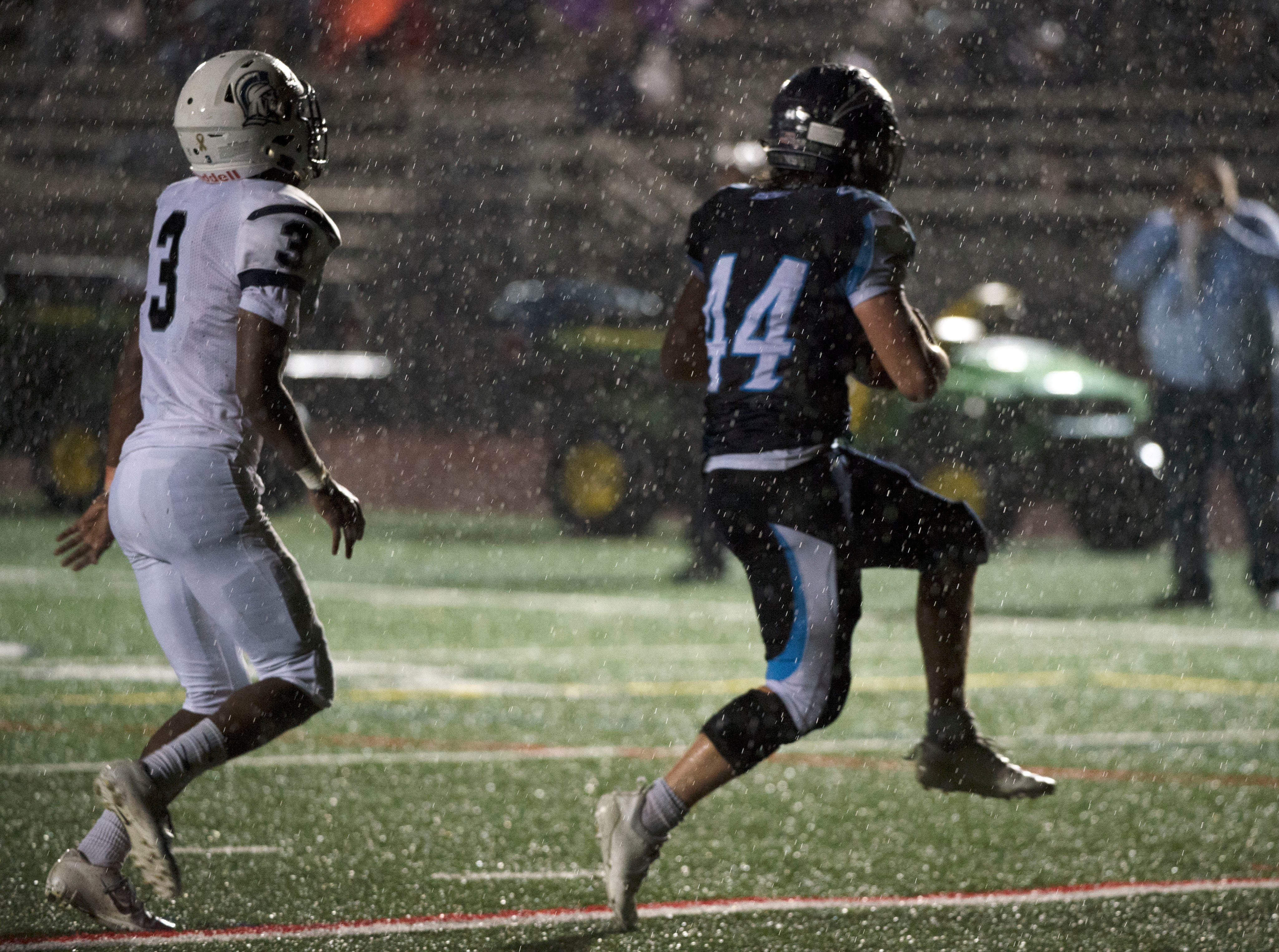 Manheim Central's Jaden Floyd (44) takes the ball in for a score. Chambersburg Trojans dropped a close game 20-17 to Manheim Township Blue Streaks in the rain during PIAA District 3 playoff football on Friday, Nov. 2, 2018.