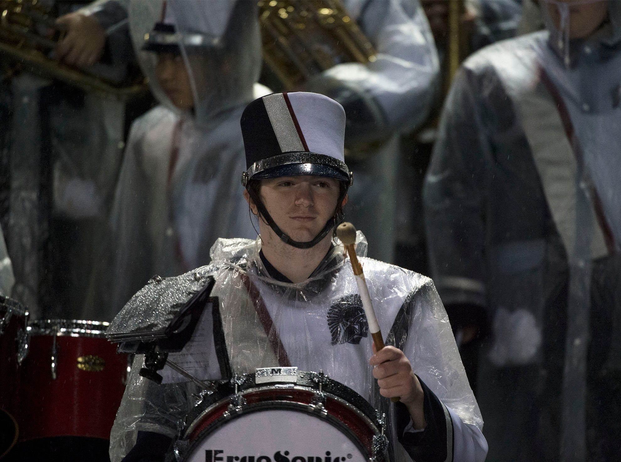 Chambersburg Marching Band members are geared for the rain. Chambersburg Trojans dropped a close game 20-17 to Manheim Township Blue Streaks in the rain during PIAA District 3 playoff football on Friday, Nov. 2, 2018.