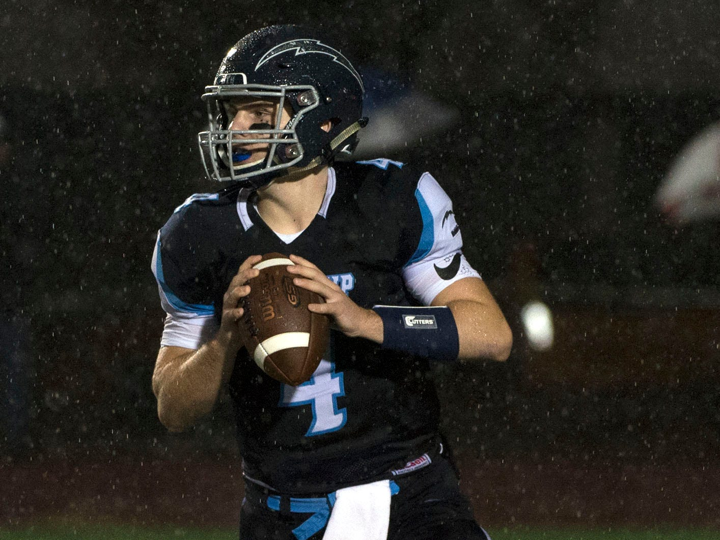 Manheim Township's Harry Kirk scrambles to pass the ball. Chambersburg Trojans dropped a close game 20-17 to Manheim Township Blue Streaks in the rain during PIAA District 3 playoff football on Friday, Nov. 2, 2018.