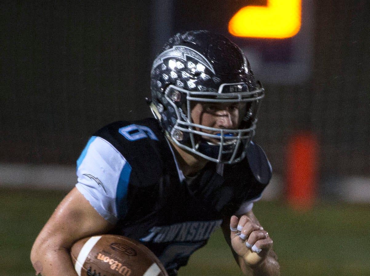 Manheim Central's Brett Benjamin runs the ball in the first half. Chambersburg Trojans dropped a close game 20-17 to Manheim Township Blue Streaks in the rain during PIAA District 3 playoff football on Friday, Nov. 2, 2018.