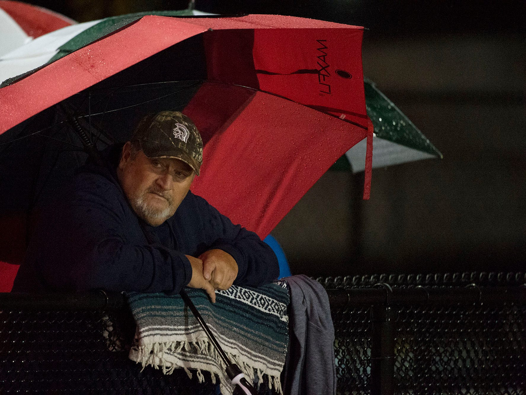 Fans needed rain gear to watch the game. Chambersburg Trojans dropped a close game 20-17 to Manheim Township Blue Streaks in the rain during PIAA District 3 playoff football on Friday, Nov. 2, 2018.