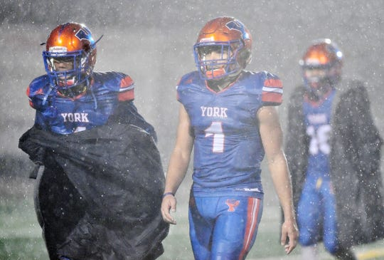 York High players are seen here during a torrential downpour Friday night during the Bearcats' 42-7 victory over Northern York in a District 3 Class 5-A first-round football game. Dawn J. Sagert photo