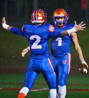 York High's Tobee Stokes, front, and Dayjure Stewart celebrate a touchdown made by Stewart during District 3, Class 5-A first-round football playoff action against Northern York at Smalls Athletic Field in York City, Friday, Nov. 2, 2018. York High would win the game 42-7. Dawn J. Sagert photo