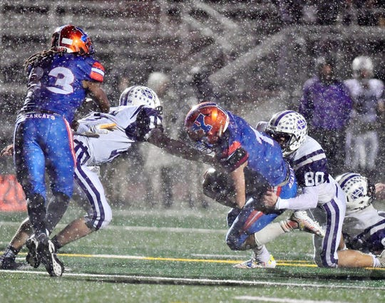 York High battles Northern York during a rainy Friday night at Small Field in a District 3 Class 5-A playoff game. Dawn J. Sagert photo