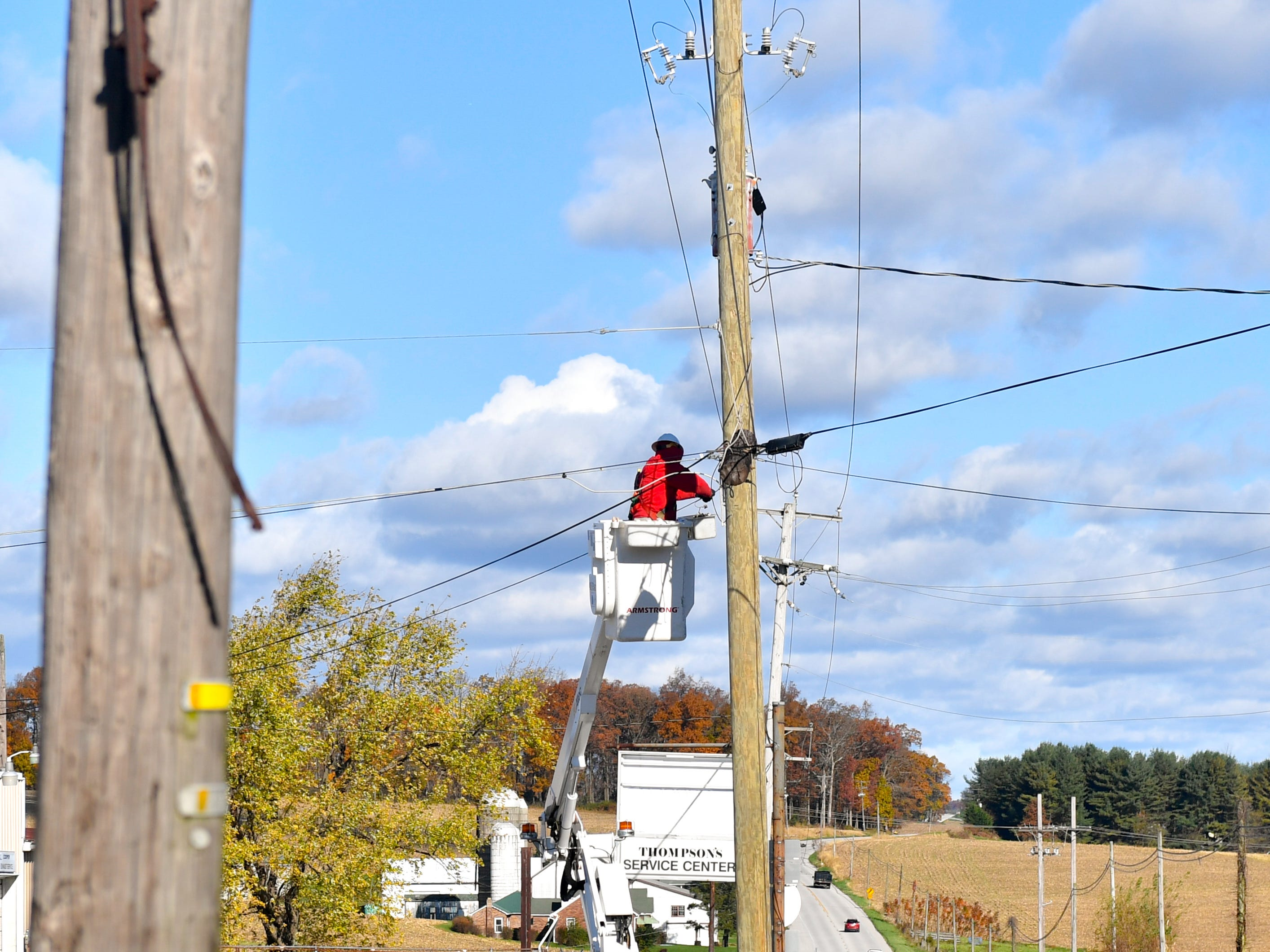 Electricians fix phone lines effected by the storm, November 3, 2018.