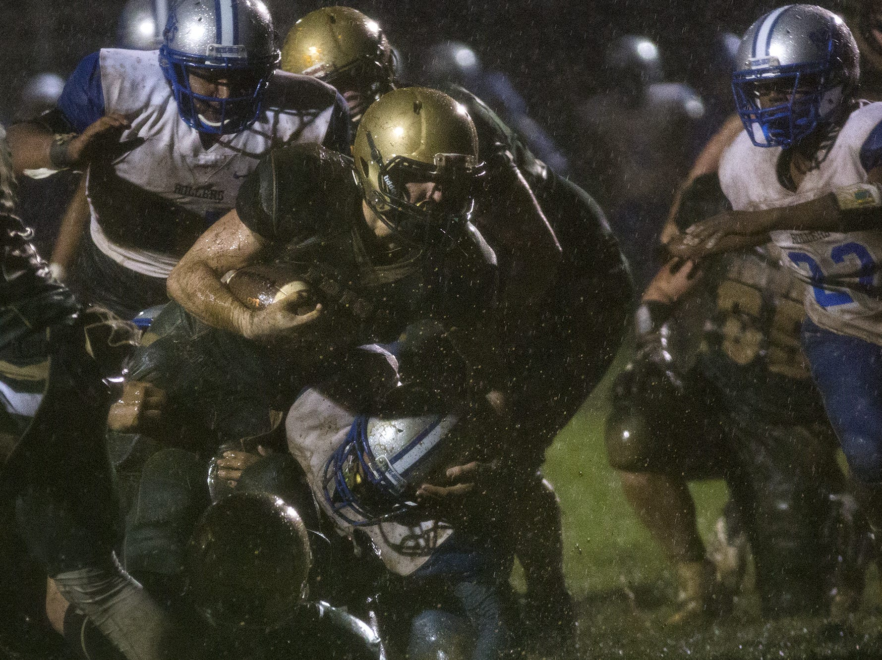 A York Catholic ball carrier fights for extra yards. York Catholic defeats Steelton-Highspire 21-0 in a District 3 Class 2A semifinal football game at York Catholic High School in York, Friday, November 2, 2018.