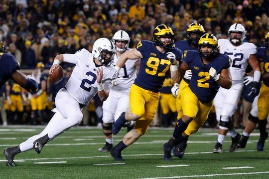 Penn State quarterback Tommy Stevens (2) runs for a 8-yard touchdown against Michigan in the second half of an NCAA college football game in Ann Arbor, Mich., Saturday, Nov. 3, 2018. (AP Photo/Paul Sancya)