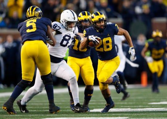 Michigan defensive back Brandon Watson (28) returns an interception 62-yards for a touchdown in the second half of an NCAA college football game against Penn State in Ann Arbor, Mich., Saturday, Nov. 3, 2018. (AP Photo/Paul Sancya)