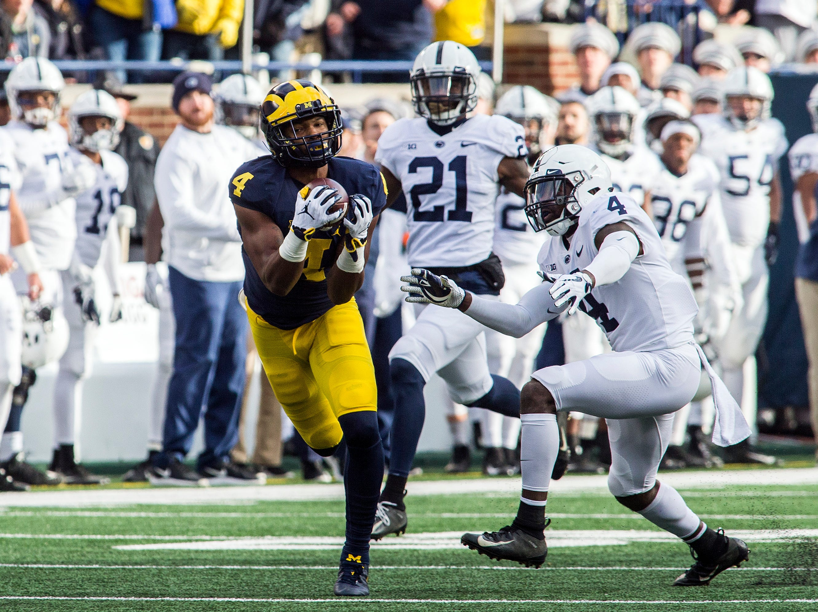 Michigan wide receiver Nico Collins, left, makes a 47-yard reception, defended by Penn State safety Nick Scott (4) in the second quarter of an NCAA college football game in Ann Arbor, Mich., Saturday, Nov. 3, 2018. (AP Photo/Tony Ding)