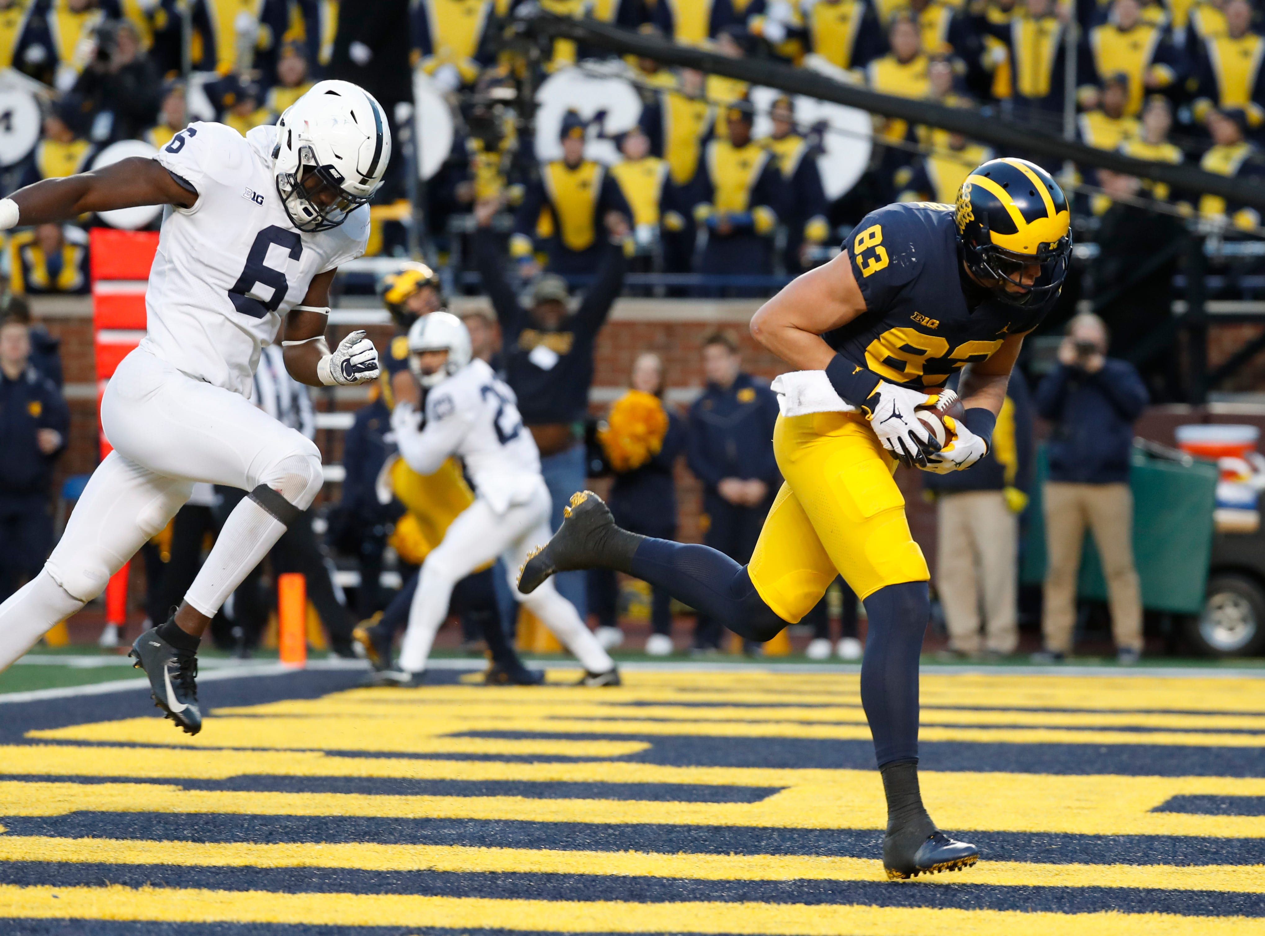 Michigan tight end Zach Gentry (83) catches a 7-yard touchdown pass as Penn State linebacker Cam Brown (6) defends in the second half of an NCAA college football game in Ann Arbor, Mich., Saturday, Nov. 3, 2018. (AP Photo/Paul Sancya)