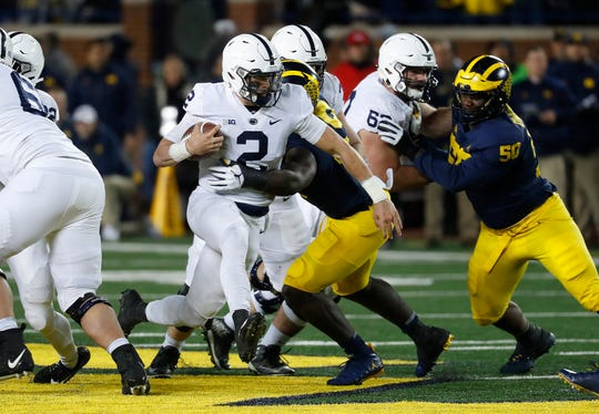 Penn State quarterback Tommy Stevens (2) runs against Michigan in the second half of an NCAA college football game in Ann Arbor, Mich., Saturday, Nov. 3, 2018. (AP Photo/Paul Sancya)
