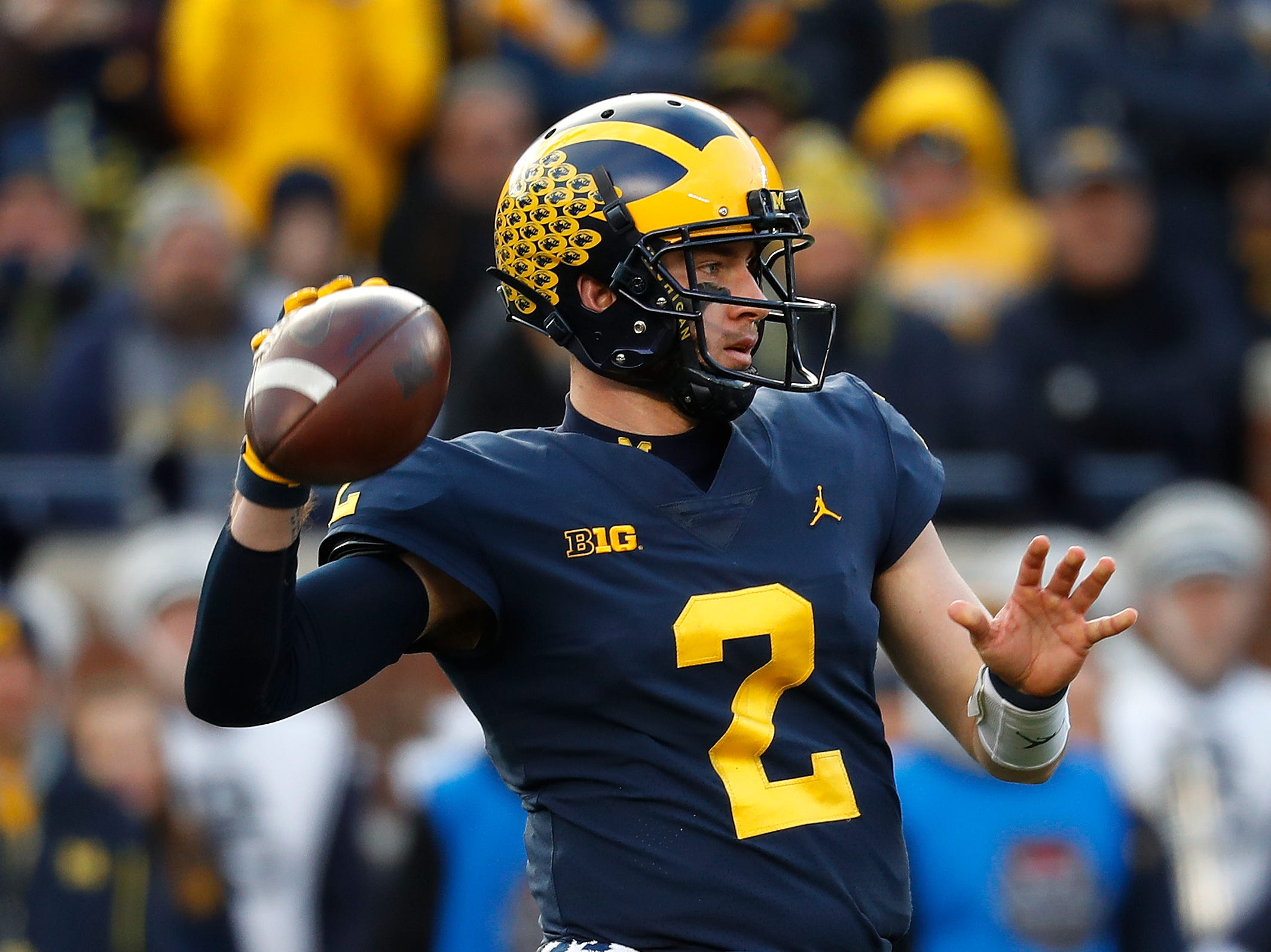 Michigan quarterback Shea Patterson throws against the Penn State in the first half of an NCAA college football game in Ann Arbor, Mich., Saturday, Nov. 3, 2018. (AP Photo/Paul Sancya)