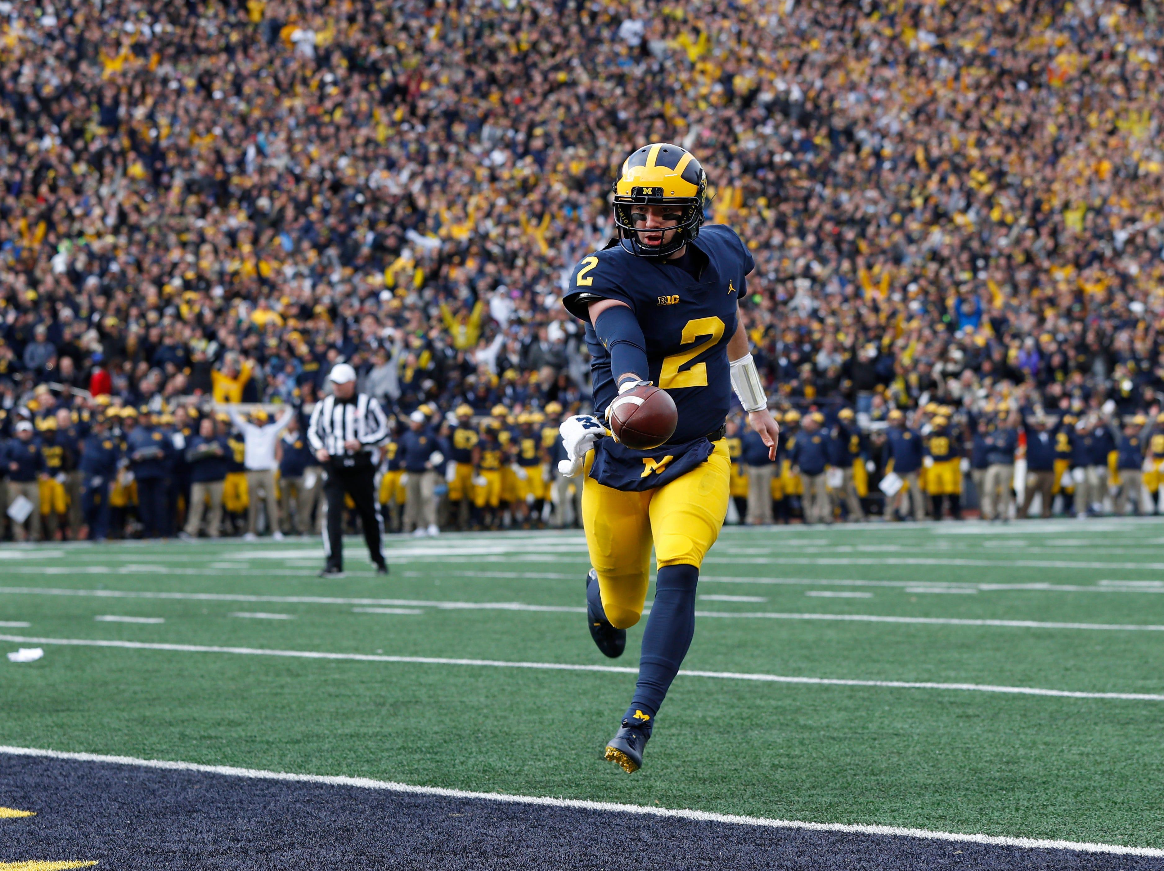 Michigan quarterback Shea Patterson runs for a one-yard touchdown against Penn State in the first half of an NCAA college football game in Ann Arbor, Mich., Saturday, Nov. 3, 2018. (AP Photo/Paul Sancya)