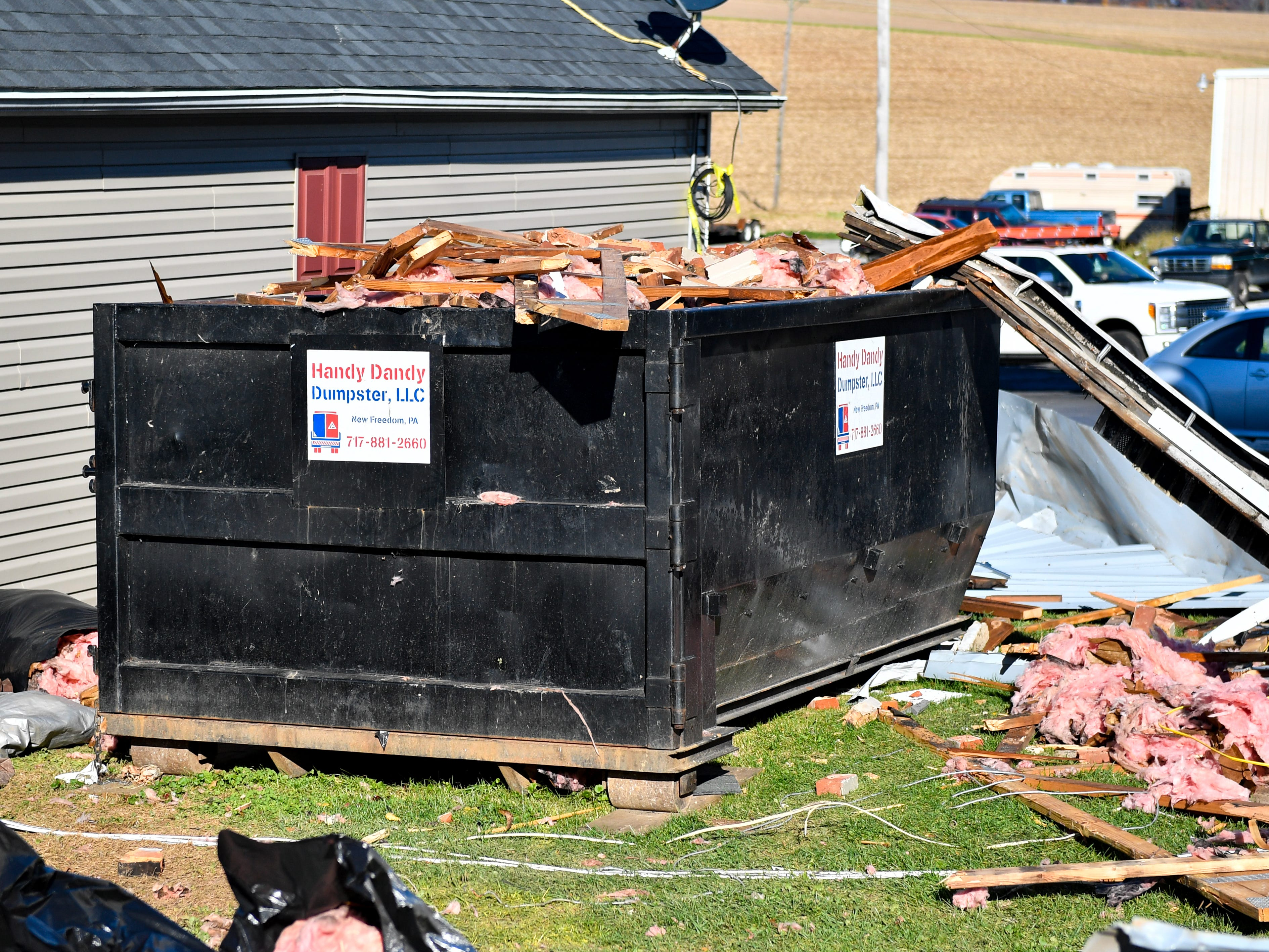 People working on the salon's roof have filled this dumpster with debris, November 3, 2018.