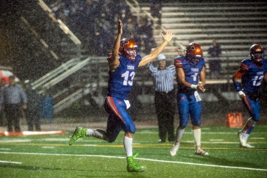 York High quarterback Seth Bernstein (13) celebrates a touchdown during District 3 Class 5A playoff game abasing the Northern York Polar Bears at Small Field, Friday, Nov. 2, 2018. The Bearcats beat the Polar Bears, 42-7.