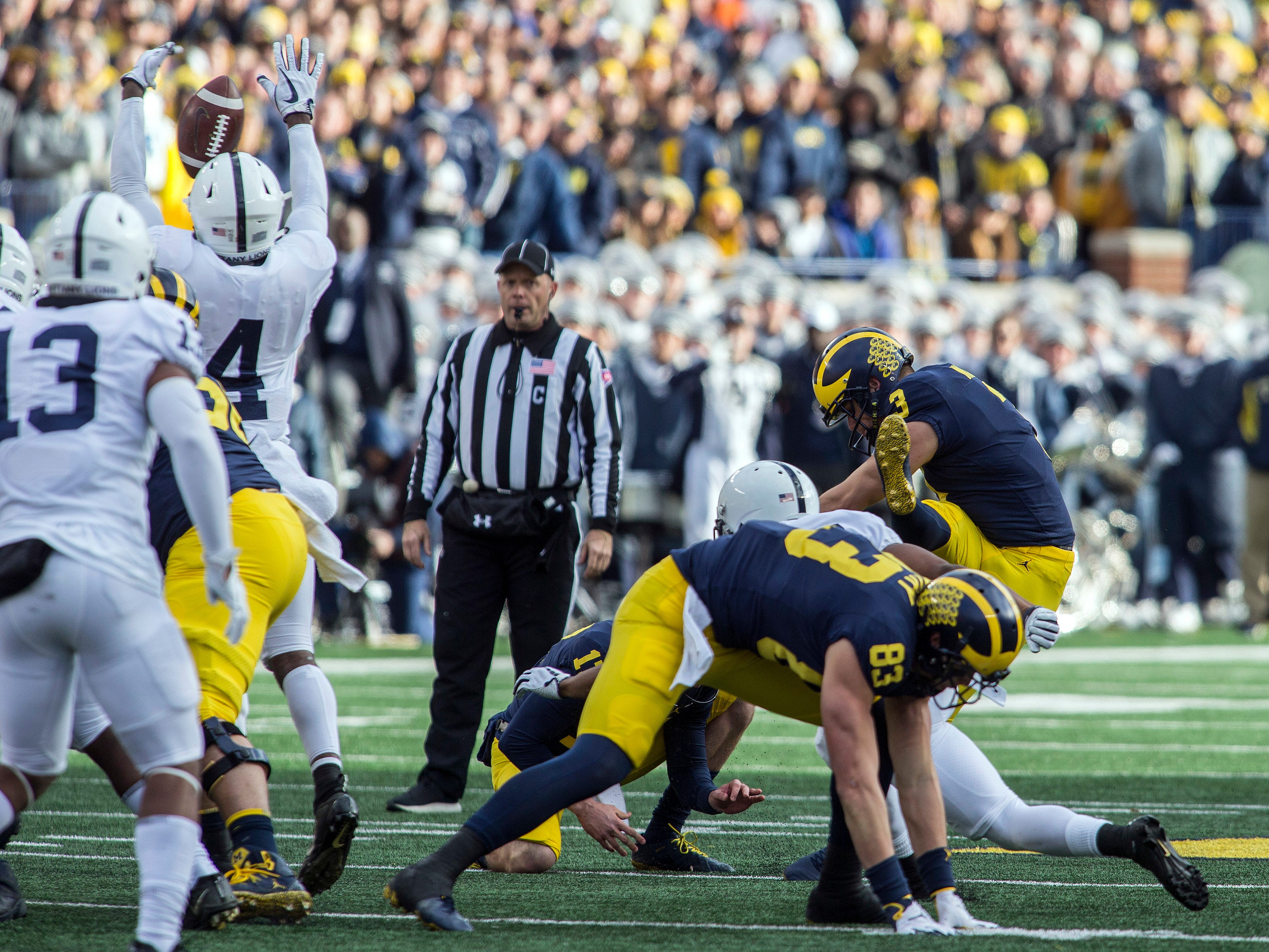 Michigan kicker Quinn Nordin (3) has a 50-yard field goal attempt blocked by Penn State safety Nick Scott (4) in the second quarter of an NCAA college football game in Ann Arbor, Mich., Saturday, Nov. 3, 2018. (AP Photo/Tony Ding)