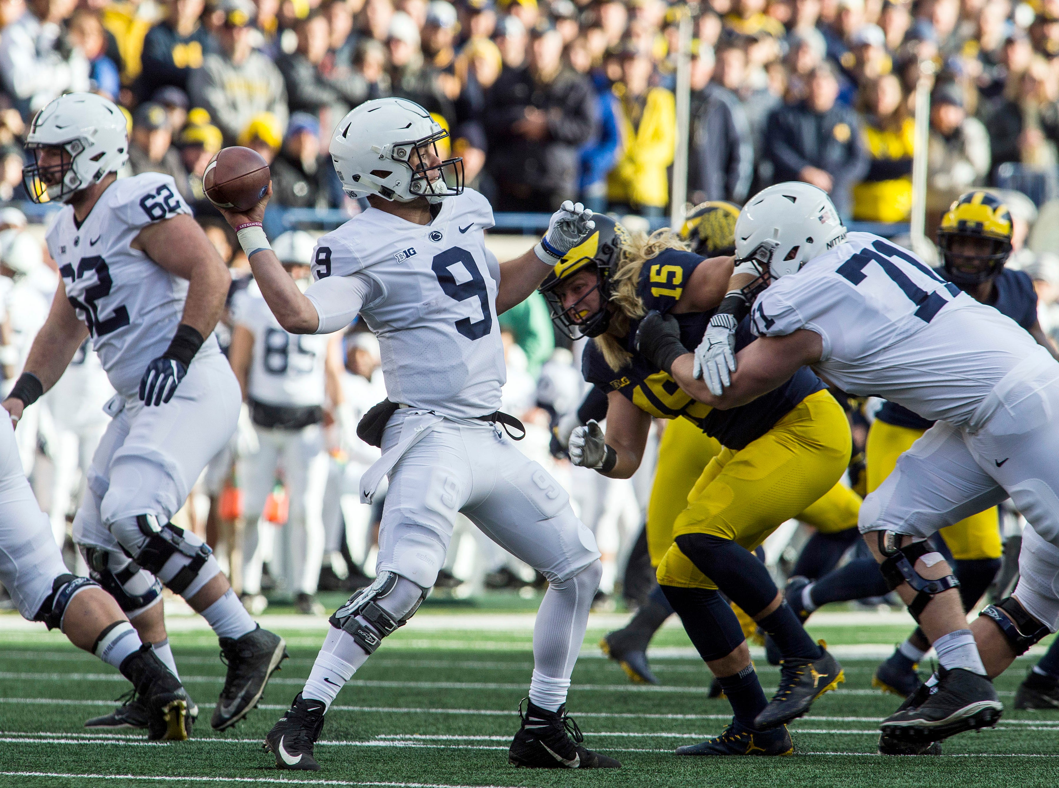 Penn State quarterback Trace McSorley (9) throws a pass, aided by a block from offensive lineman Will Fries (71) on Michigan defensive lineman Chase Winovich (15), in the second quarter of an NCAA college football game in Ann Arbor, Mich., Saturday, Nov. 3, 2018. (AP Photo/Tony Ding)