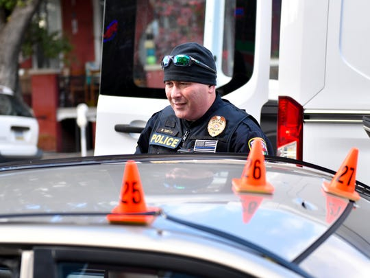Officer Smith inspects the rear car door, November 3, 2018.