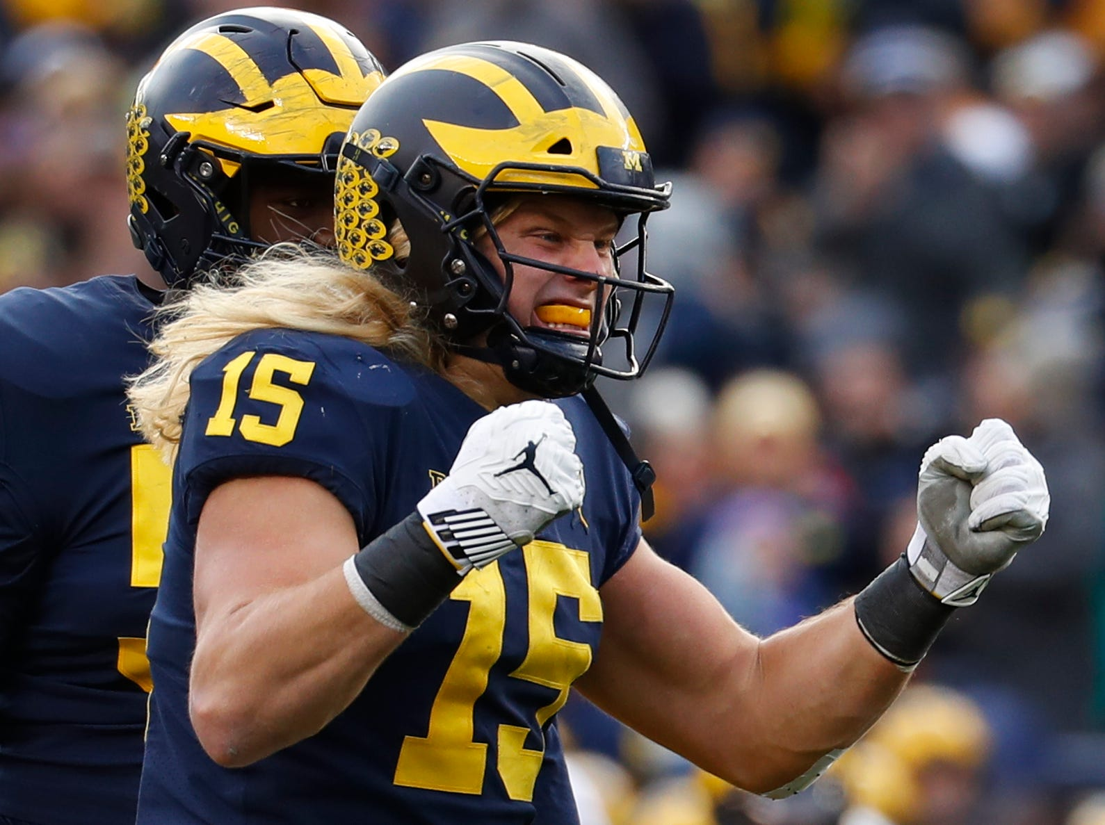 Michigan defensive lineman Chase Winovich (15) celebrates a stop against Penn State in the first half of an NCAA college football game in Ann Arbor, Mich., Saturday, Nov. 3, 2018. (AP Photo/Paul Sancya)