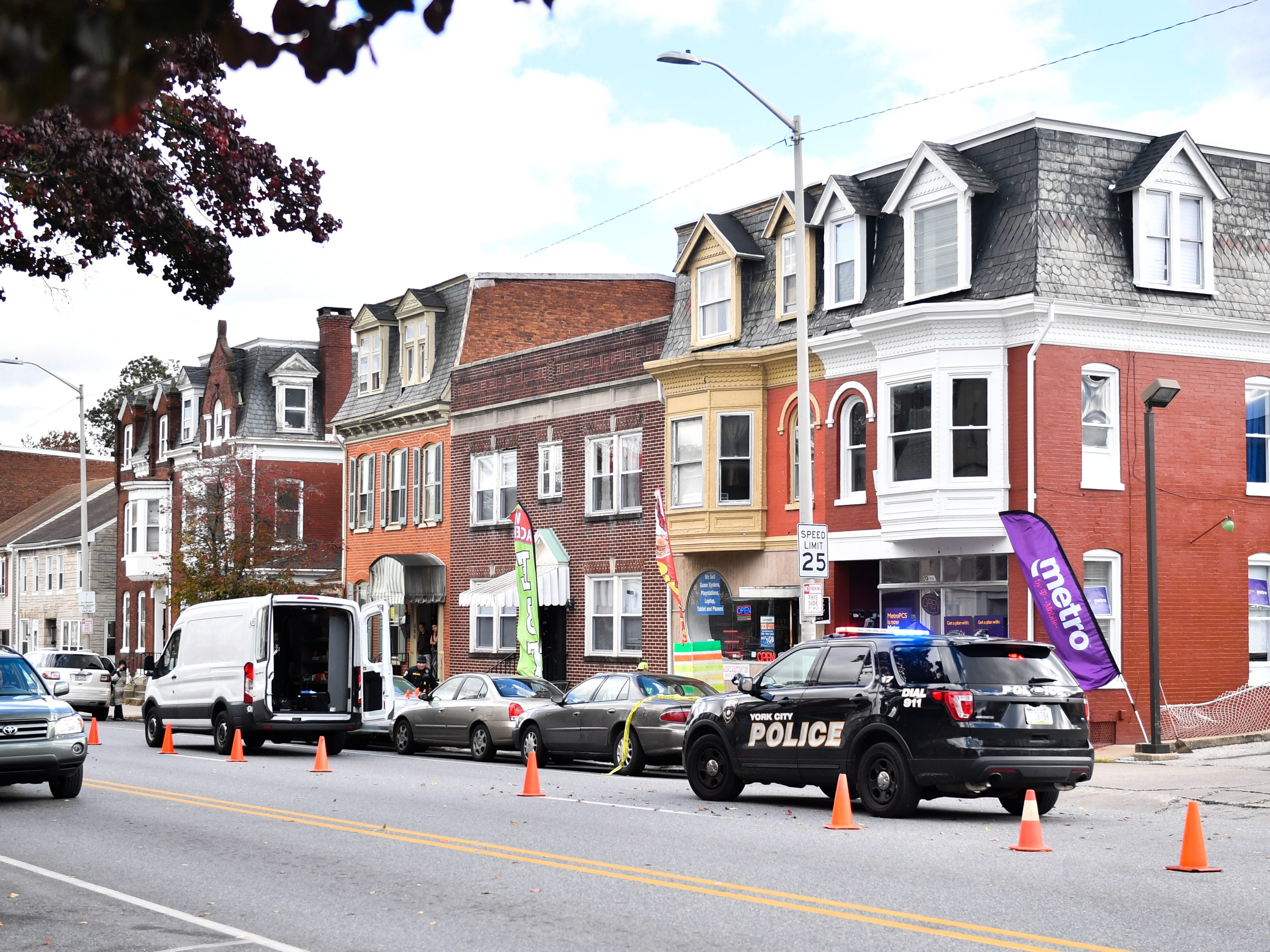 Police shut down one side of the 500 block of West Market Street, while investigating the shooting, November 3, 2018.