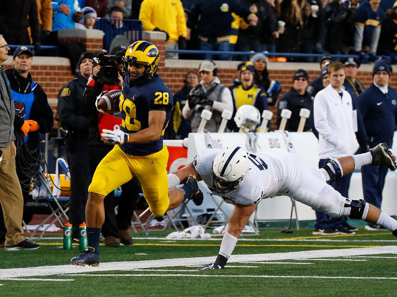 Michigan defensive back Brandon Watson (28) returns an interception for a 62-yard touchdown against Penn State in the second half of an NCAA college football game in Ann Arbor, Mich., Saturday, Nov. 3, 2018. (AP Photo/Paul Sancya)