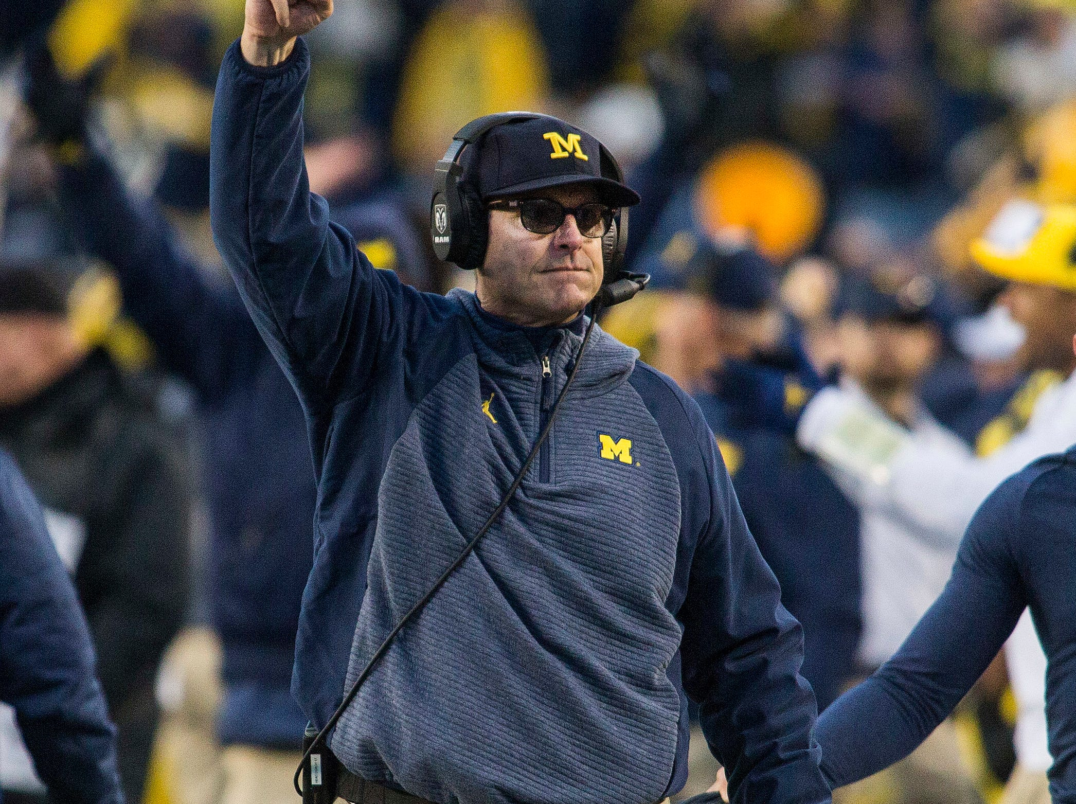 Michigan head coach Jim Harbaugh celebrates an official's confirmation on a Michigan touchdown in the third quarter of an NCAA college football game against Penn State in Ann Arbor, Mich., Saturday, Nov. 3, 2018. Michigan won 42-7. (AP Photo/Tony Ding)