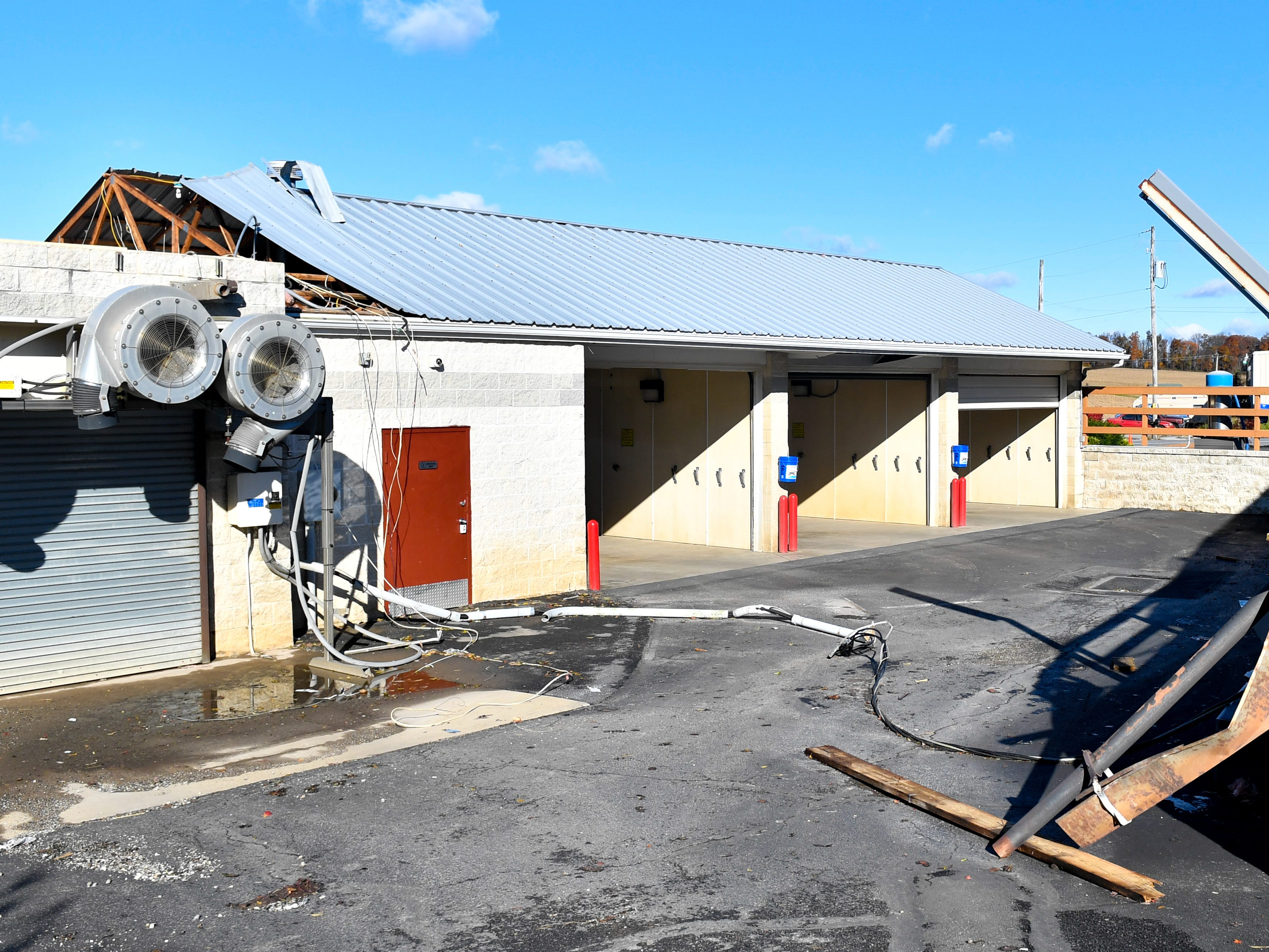 The Cornerstone Car Wash and Laundromat also took some damage. Exposed wires lay on the ground, November 3, 2018.