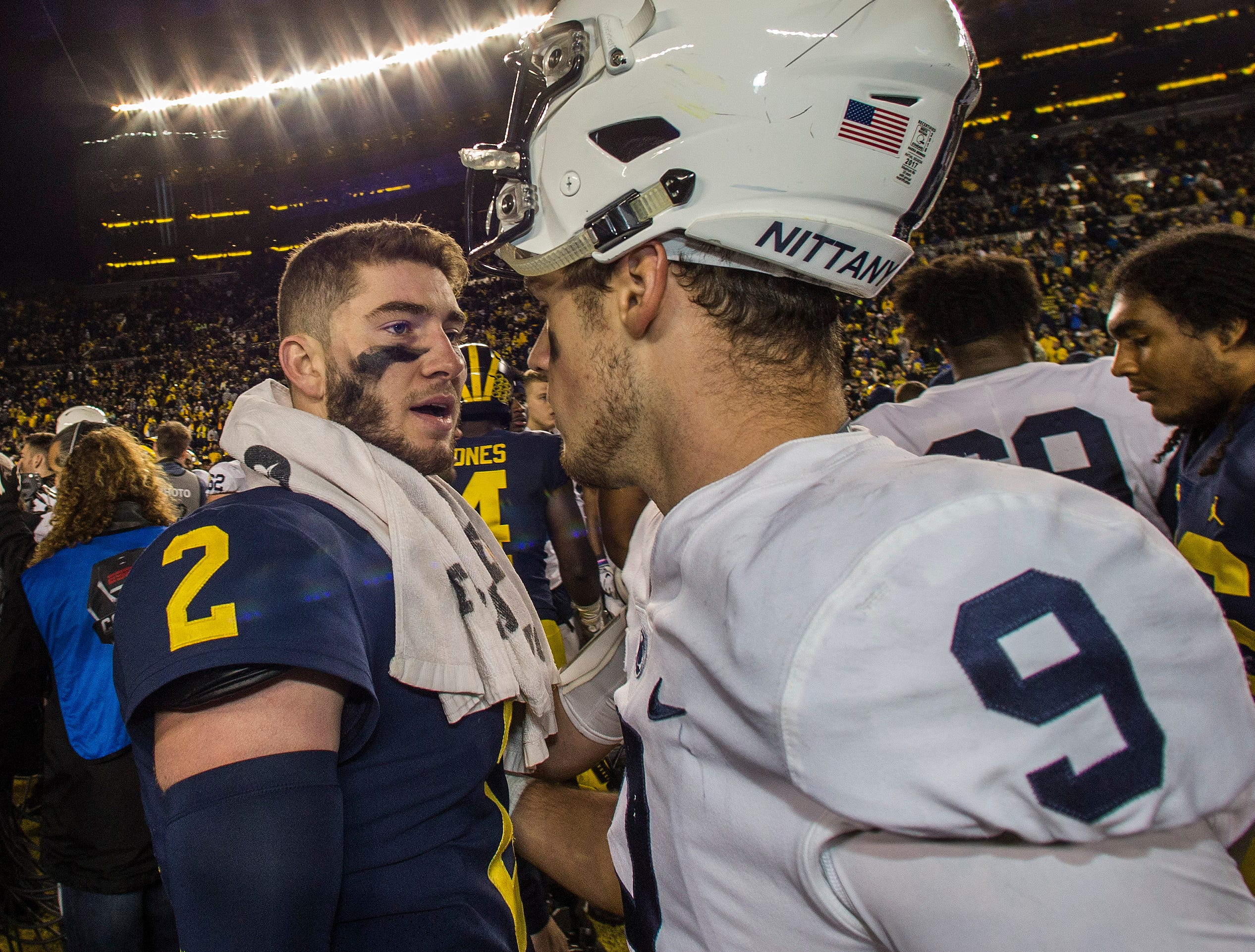 Michigan quarterback Shea Patterson (2) meets with Penn State quarterback Trace McSorley (9) after an NCAA college football game in Ann Arbor, Mich., Saturday, Nov. 3, 2018. Michigan won 42-7. (AP Photo/Tony Ding)
