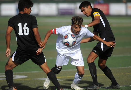 Spanish Springs' Wilmer Hernandez splits a pair of Galena defenders during their regional final soccer game at Damonte Ranch in Reno on Nov. 3, 2018.