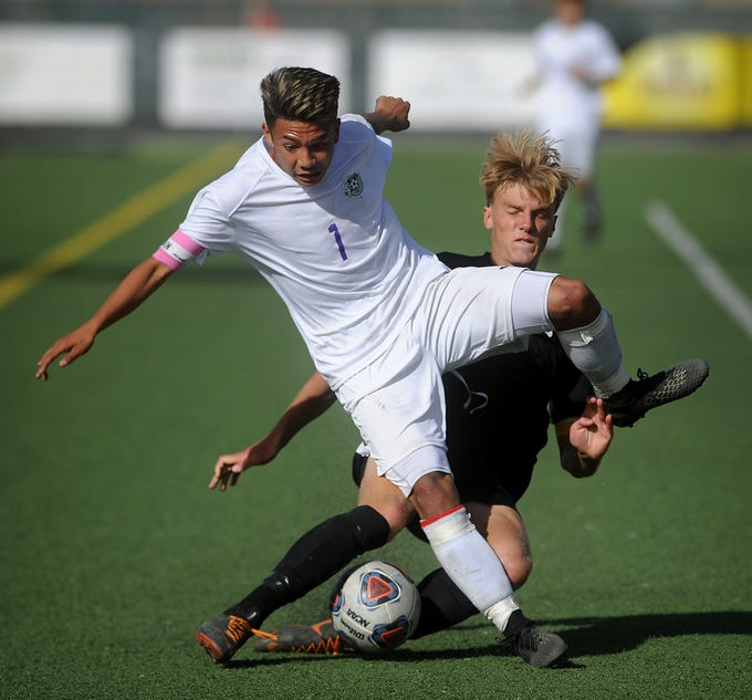 Spanish Springs' Allen Somera (1) fights for the ball with Galena's Richard Debold during their regional final soccer game at Damonte Ranch in Reno on Nov. 3, 2018.