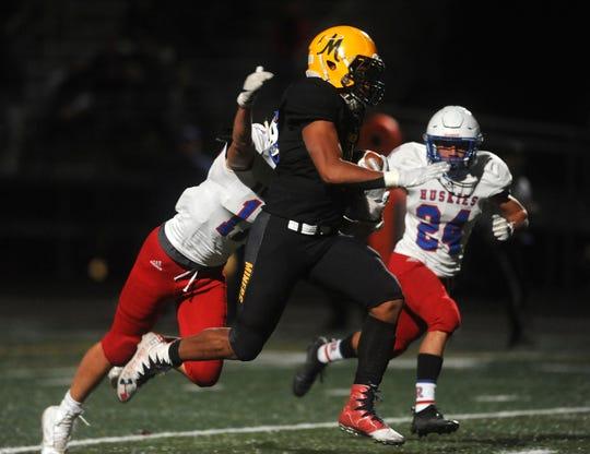 Bishop Manogue's Peyton Dixon runs free for a touchdown while taking on Reno during their playoff football game at Manogue on Nov. 2, 2018.