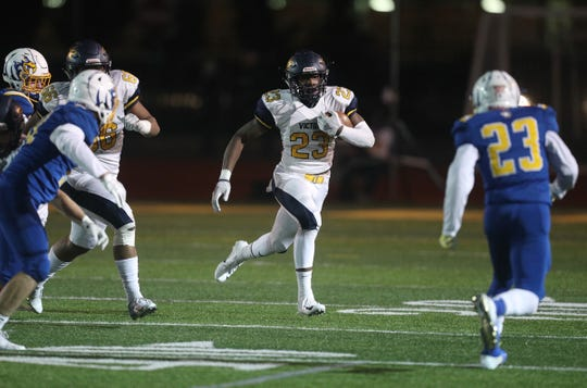 Victor's Rushawn Baker tries to get outside against Irondequoit.