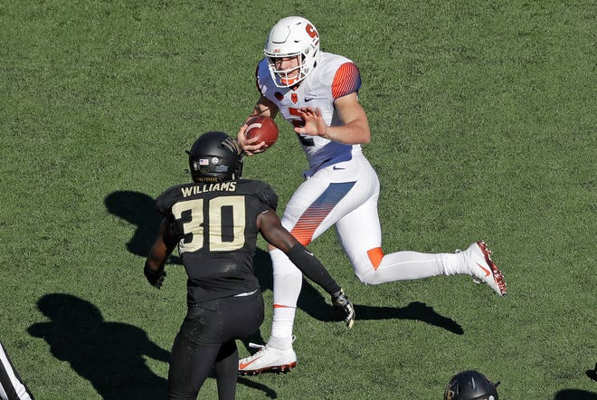 Syracuse's Eric Dungey runs as Wake Forest's Ja'Cquez Williams defends in the second half.