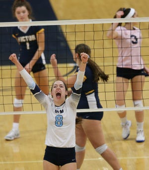 Mercy #8 Liza Huber against Victor at the Section V volleyball championship.