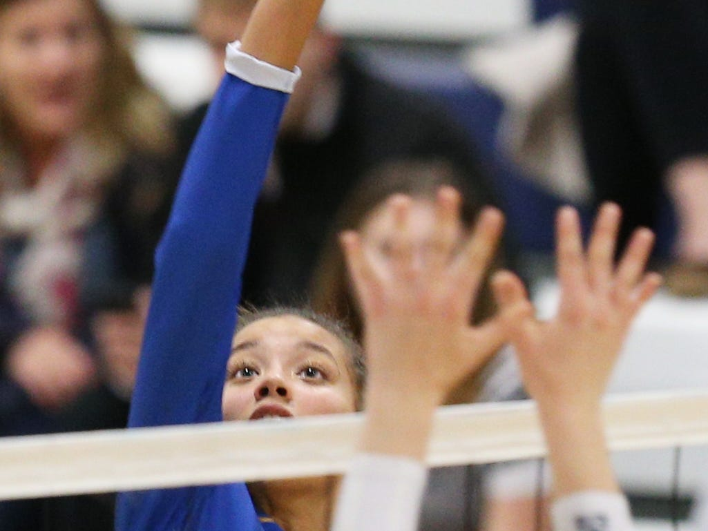 Irondequoit #4 Drew Kemp at the Section V volleyball championship against Pittsford Sutherland.