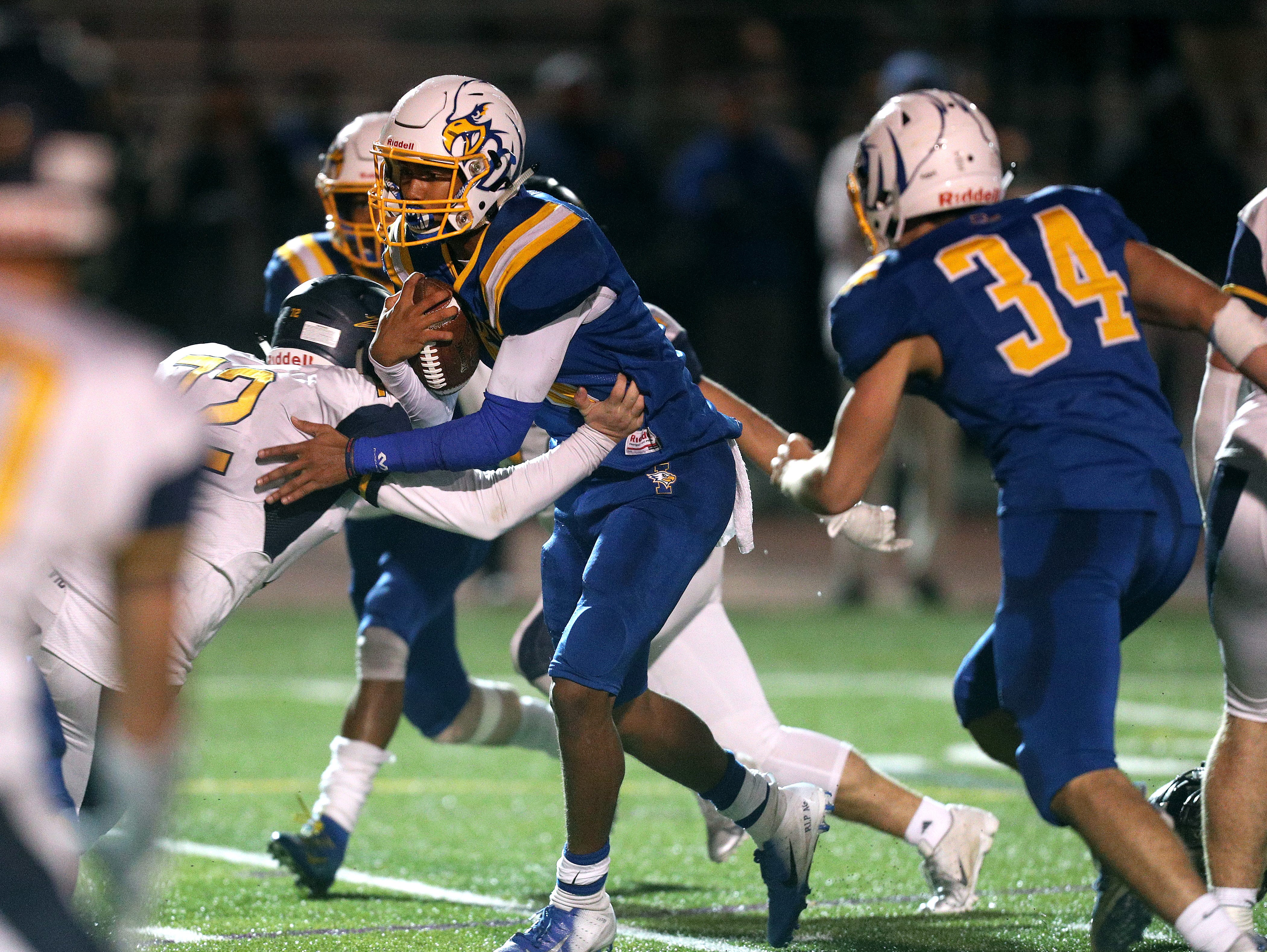Irondequoit's Freddy June Jr. fights through a tackle to score the winning touchdown to beat Victor and the Class A title.
