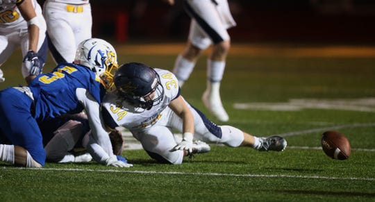 Victor running back Joey Pezzimenti loses the ball near the sideline. The ball was recovered by Irondequoit.