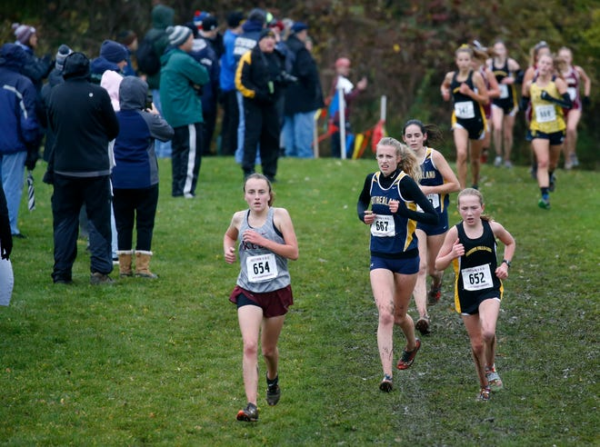 Pittsford Sutherland senior Rebekah Preisser (No. 667, center) overcame injuries in the past three seasons to with the Section V Class B race Saturday at Midlakes.