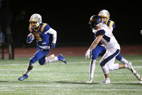 Irondequoit running back Jadon Turner breaks through the line for a long run against Victor.