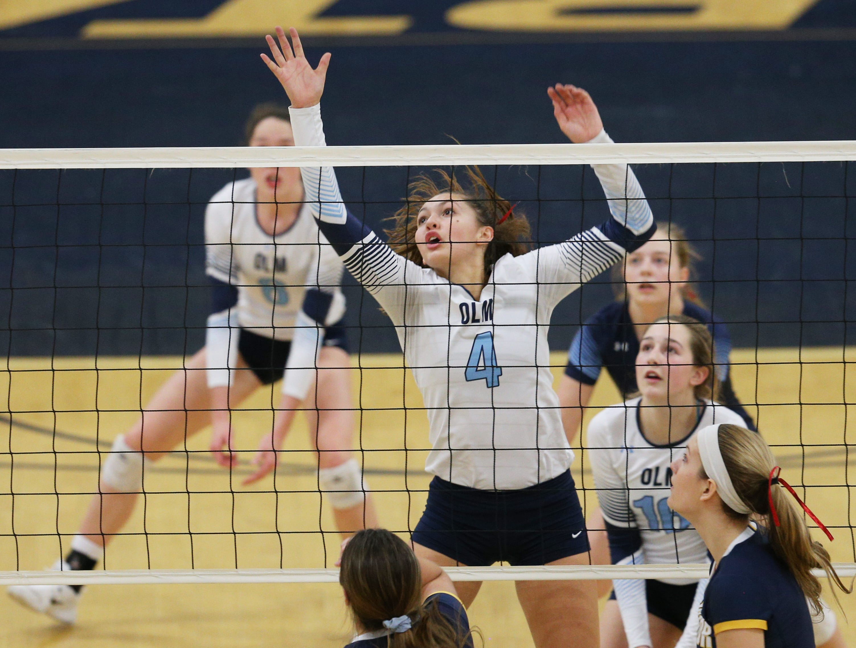 Mercy #4 Lily Witkoski against Victor at the Section V volleyball championship.