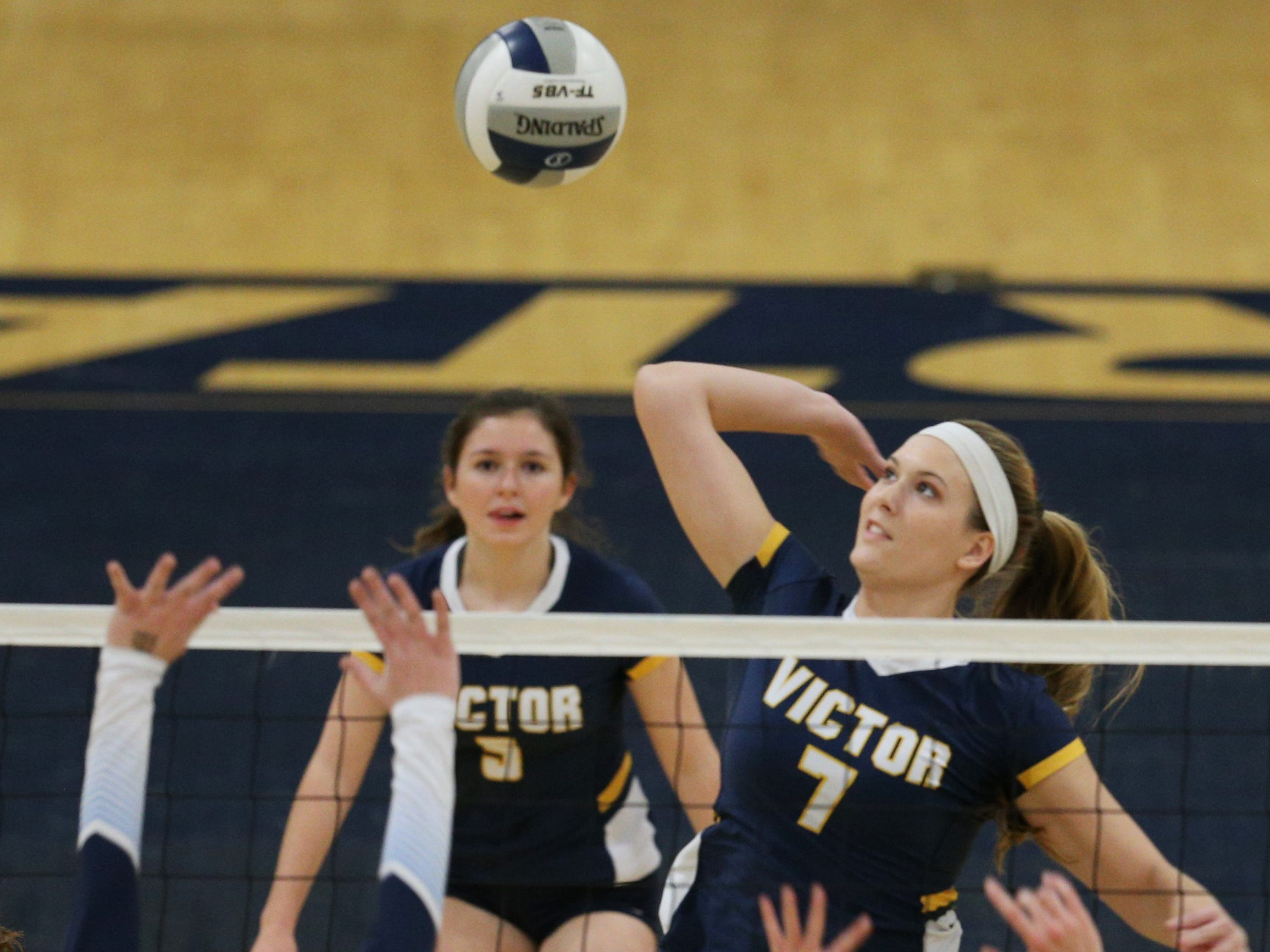 Victor #7 Makenzie Bills against  Mercy at the Section V volleyball championship.