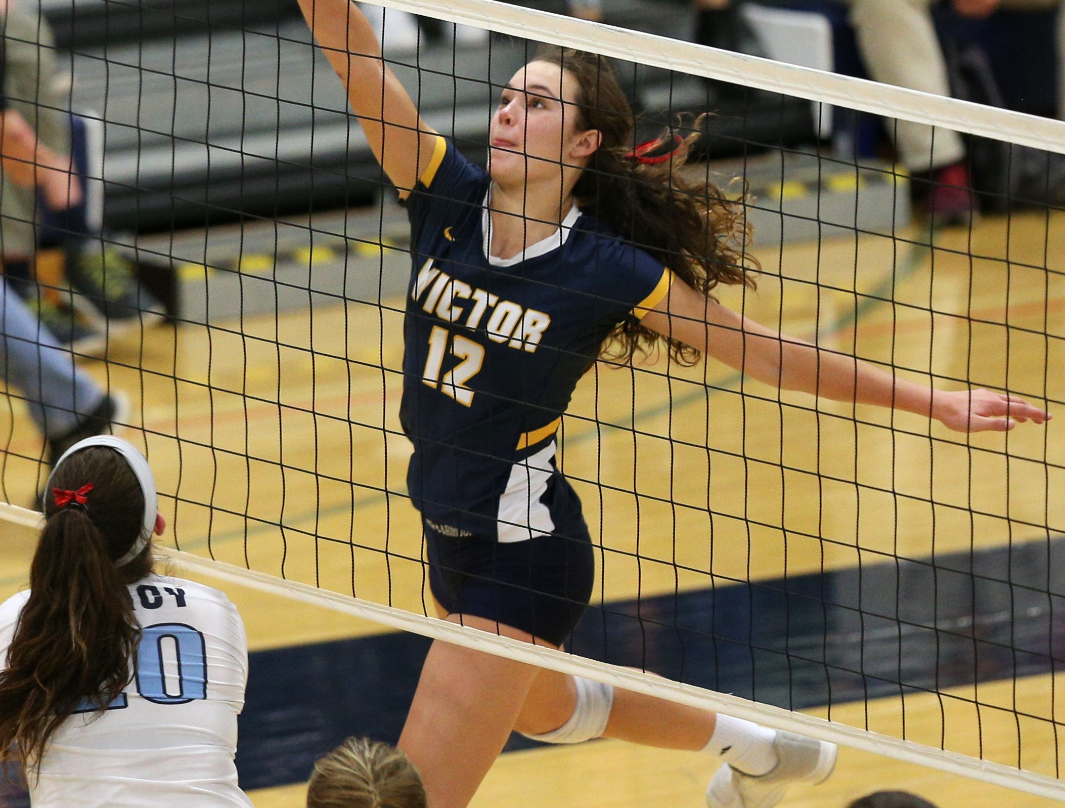 Victor #12 Emma Werkmeister against  Mercy at the Section V volleyball championship.