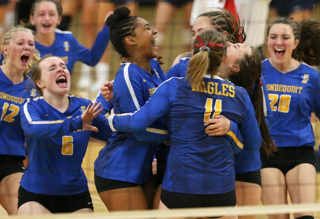 Irondequoit High School celebrates their win over Pittsford Sutherland.
